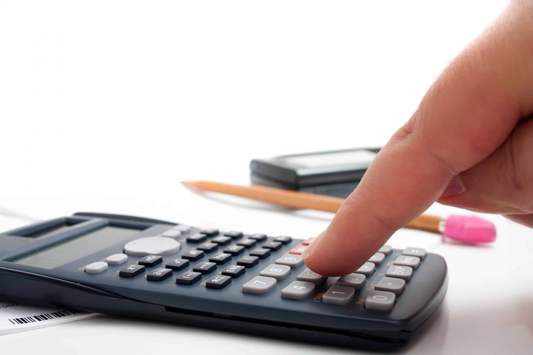 a-finger-adding-up-figures-using-a-calculator-isolated-over-a-white-background_BKf-vXDRrs